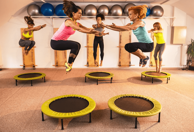 Group of Women Jumping On Trampoline